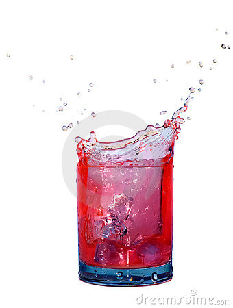 Splash in a glass of red fluid isolated on white