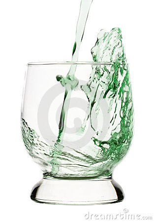 Splash, green drink is being poured into glass