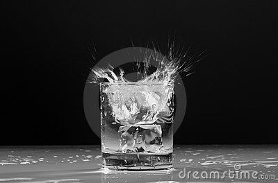 Splash ice cube in the glass