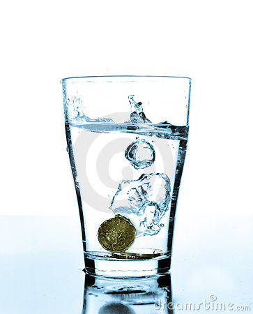 Free Splash Of Water And Coins In A Glass Royalty Free Stock Photos - 16460728