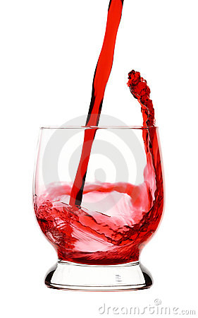 Splash, red wine is being poured into glass,
