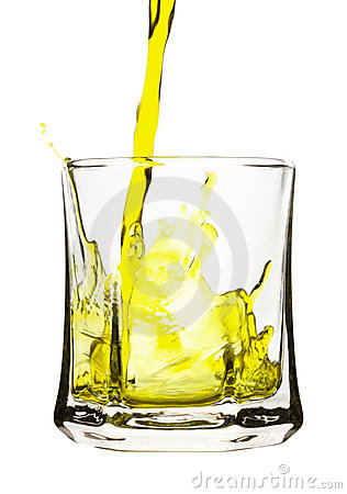 Splash, yellow drink is being poured into glass