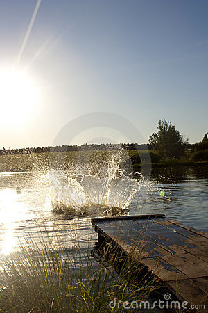 Splashes from a jump in lake