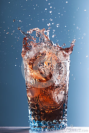 Splashing drink in glass
