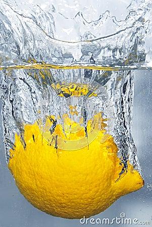 Free Splashing Lemon Into A Water Royalty Free Stock Photos - 4630478