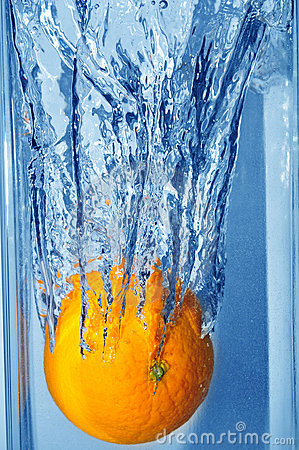 Splashing orange into a water