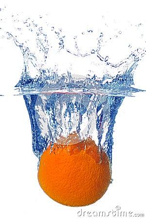 Splashing orange into a water