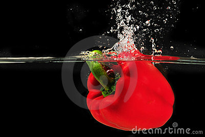 Splashing peper into a water