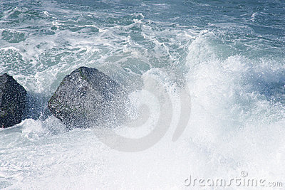 Splashing sea over rocks
