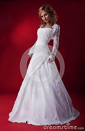 Splendid bride in white bridal dress.