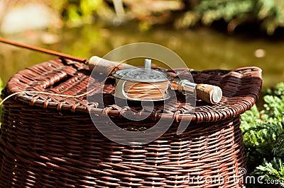 Split cane fishing rod and creel