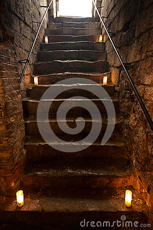 Spooky stone stairs in old castle
