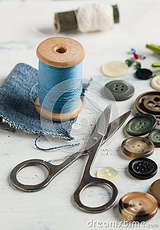 Spool of thread and scissors