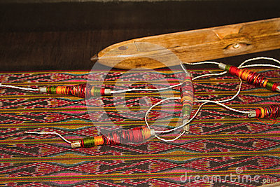 Spool of thread and wooden bobbin Thai traditional cloth weavin