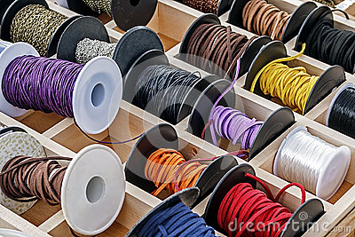 Spools with chains and colored ribbons 1