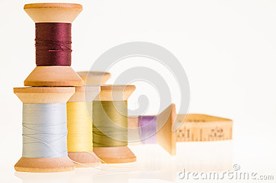 Spools of thread and a measuring tape