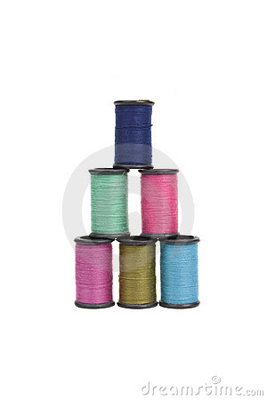 Spools of thread in a pyramid