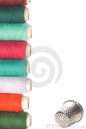 Spools of thread and thimble for sewing