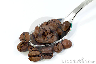 Spoon with coffee grains.