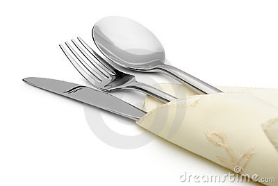 Spoon, fork and a knife lie on serviette
