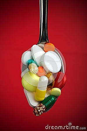 Free Spoon Full Of Various Pills Stock Photo - 26315470