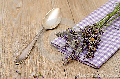 Spoon and lavender on a wooden table