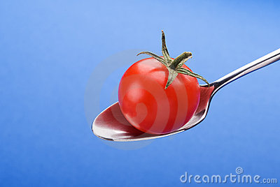 Spoon with little tomato