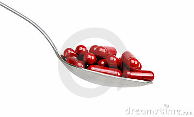 Spoon with red capsules