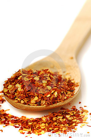 Spoon of red pepper flakes