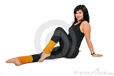 Sport brunette in black  makes gymnastic