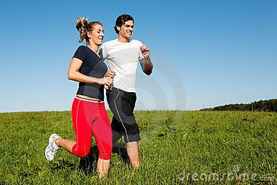 Sport couple jogging outdoors in summer