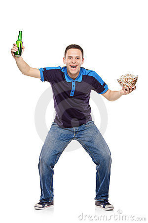 Sport fan with a bottle and popcorn in his hands