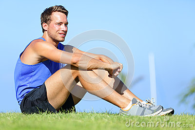 Sport fitness man relaxing after training