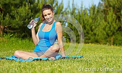 Sport fitness model outside on summer /