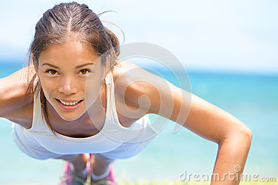 Sport fitness woman training push-ups