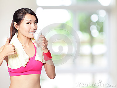 Sport girl drinking and thumb up