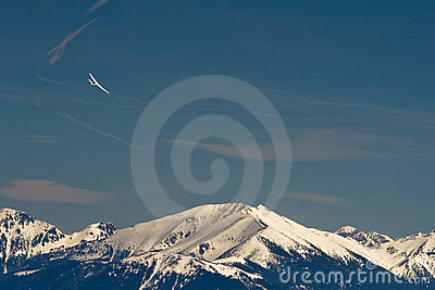 Sport glider over high mountains landscape