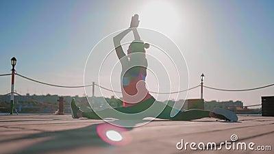 sport girl on orbitrek in the gym hard cardio workout