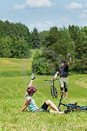 Sport mountain biking couple greeting in meadows
