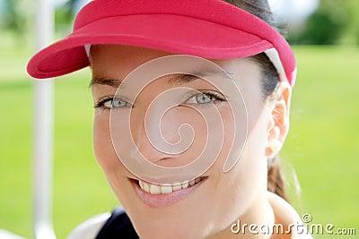 Sport woman closeup face sun visor cap