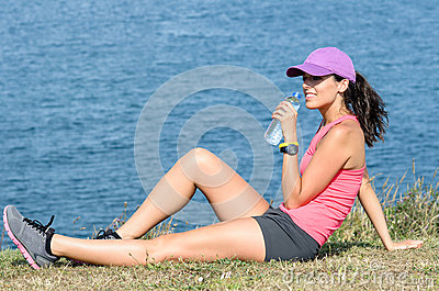 Sport woman drinking water