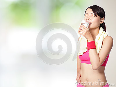 Sport woman drinking water after sport