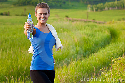 Sport woman holding water