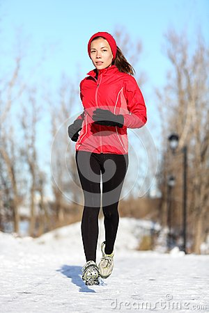 Sport woman running in winter