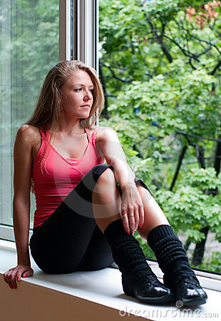 Sport woman sitting on