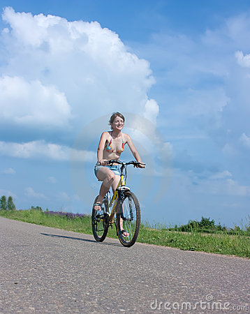 Sporting girl on a bicycle