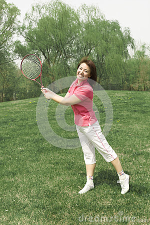 A sporting girl on grass