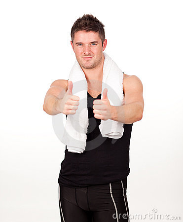Sporting man with his thumbs up to the camera