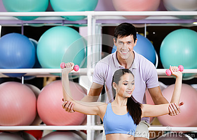 Sportive girl exercises in fitness gym