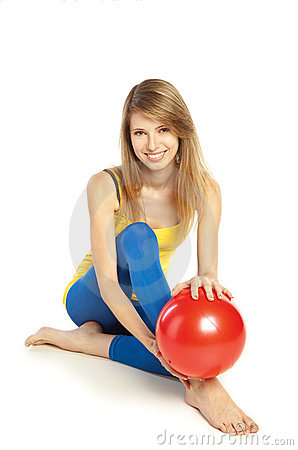 Sportive girl with red ball